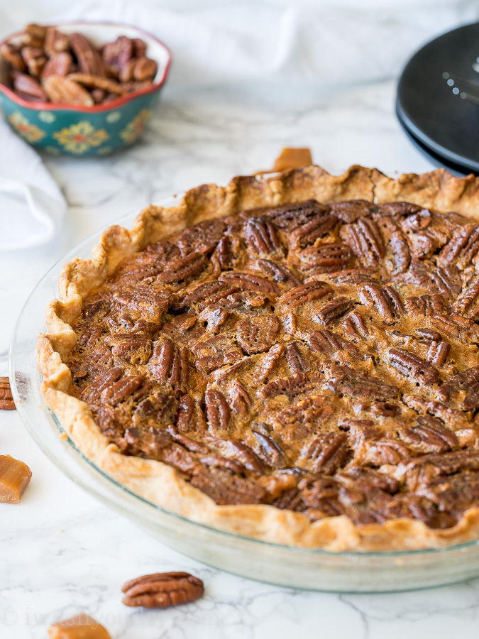 This Classic Pecan Pie Recipe has a twist of caramel which makes it the perfect addition to your holiday table!
