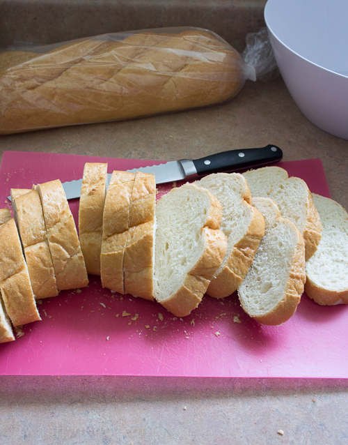 Crockpot Stuffing starts with crusty French bread. This recipe is perfect for Thanksgiving side dishes!