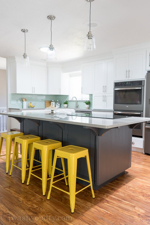 "Love the pop of color from the bar stools and back splash. Grey island paint color is ""Peppercorn"" by Sherwin Williams."