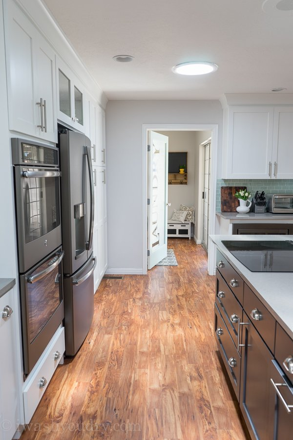 Love the natural light in this kitchen, and that Laundry Room door is stunning!