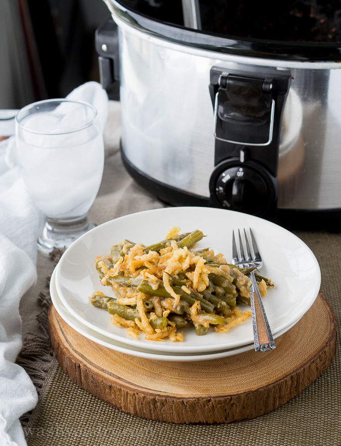 This Crock Pot Green Bean Casserole recipe is a perfect crock pot side dishes for Thanksgiving or Christmas when the oven is full.