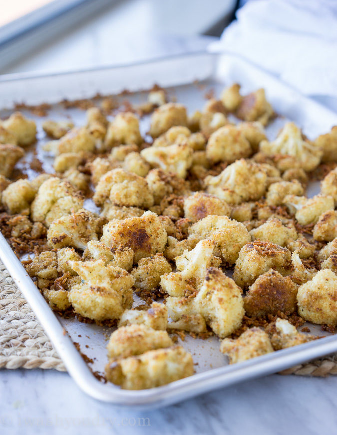 These Parmesan Roasted Cauliflower Bites are so easy to make and taste absolutely phenomenal. My whole family devoured the pan.