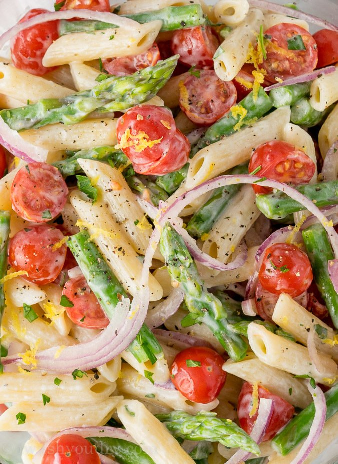This Asparagus Pasta Salad is a cool and refreshing pasta salad that is bursting with flavors of lemon and parsley. Perfect spring salad!