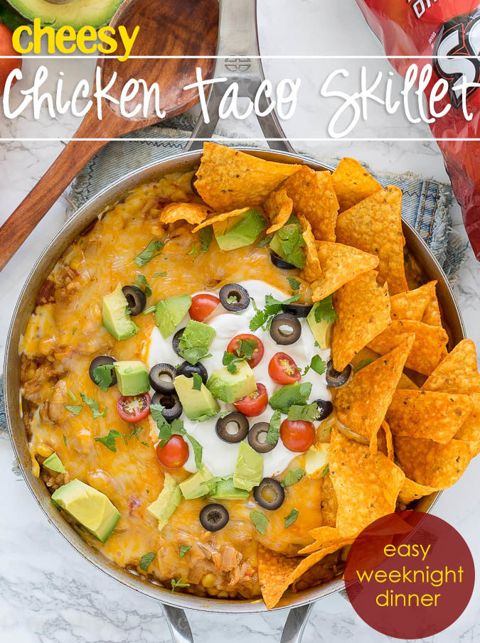This one pan, Mexican Chicken Taco Skillet is filled with chicken, rice and corn, then topped with all the yummy taco fixin's for a delicious dinner recipe that my family requests over and over again!