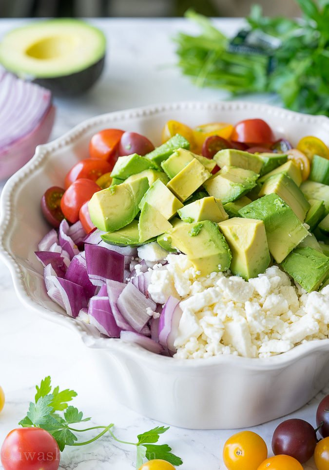 This Cucumber Tomato Avocado Salad is so fresh and delicious! I love the super simple dressing that it's tossed in!