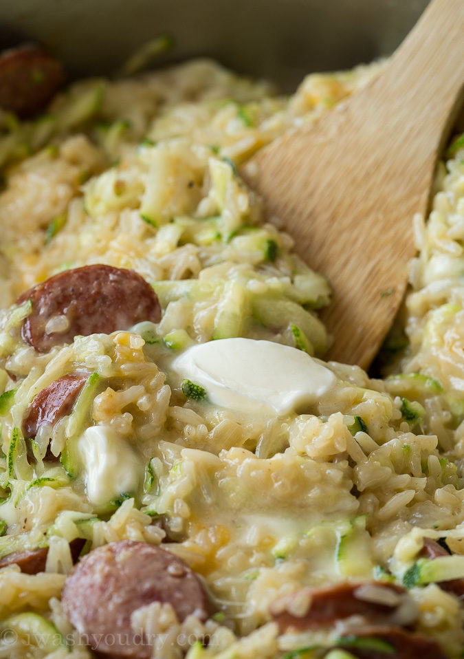 This Cheesy Sausage Zucchini Rice Skillet is a super quick dinner that's filled with everything my family loves, plus I get to sneak in some veggies!