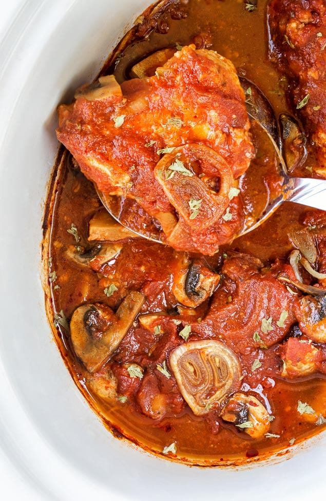 Slow Cooker Chicken Cacciatore is cooked in a crock pot; is saucy, hearty and requires only 5 main ingredients!! Hard to beat this comfort food that practically cooks itself.