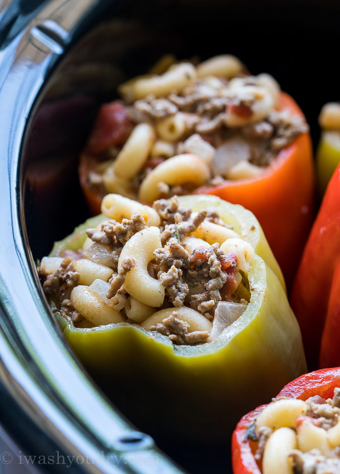 These Stuffed Bell Peppers are filled with ground beef and macaroni and cheese, then slow cooked to perfection! Such an easy weeknight dinner recipe!