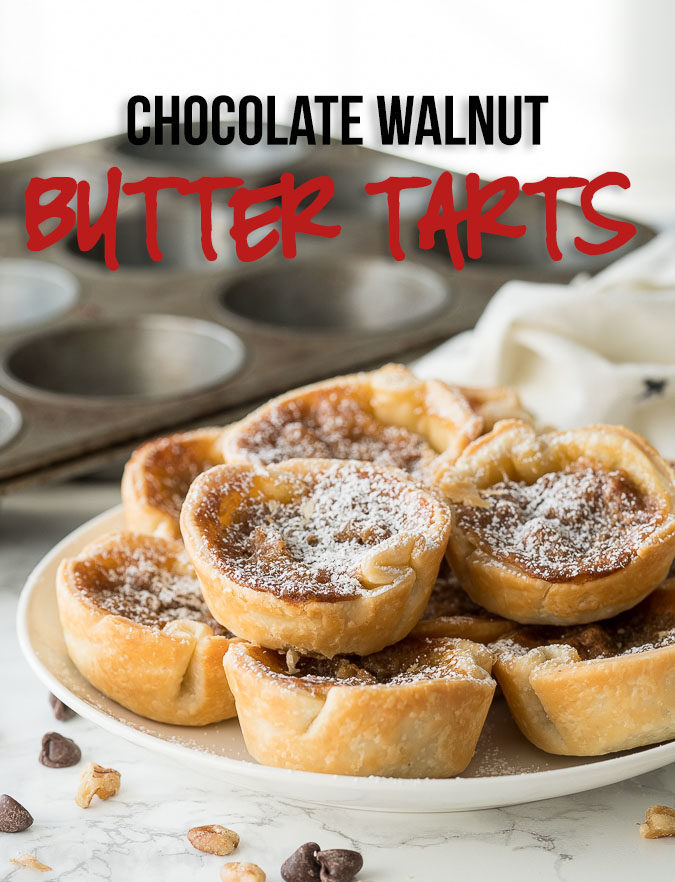 These Chocolate Walnut Butter Tarts are filled with a buttery brown sugar mixture and stuffed with chocolate and walnuts! This Canadian dessert is a must-make!